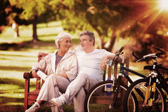 Composite image of elderly couple with their bikes Royalty Free Stock Photos