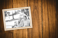Composite image of elderly couple with their bikes Royalty Free Stock Photo
