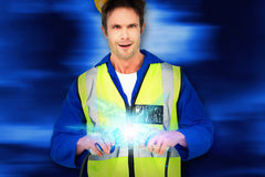 Composite image of electrician getting a shock while holding cables Royalty Free Stock Images
