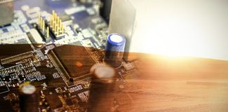 Composite image of electronic circuit board with processor. Electronic circuit board with processor against landscape in countryside during sunrise Stock Photography