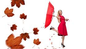 Composite image of elegant blonde holding umbrella stock image
