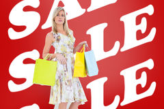 Composite image of elegant blonde with shopping bags Royalty Free Stock Photo
