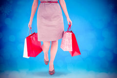 Composite image of elegant brunette with shopping bags Royalty Free Stock Image