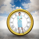 Composite image of elegant businesswoman with crossed arms Royalty Free Stock Photography