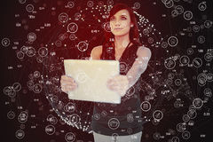 Composite image of elegant dark haired model holding tablet looking up Stock Photography