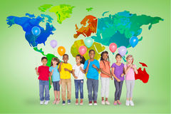 Composite image of elementary pupils holding balloons Stock Photography