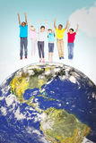 Composite image of elementary pupils jumping royalty free stock photo