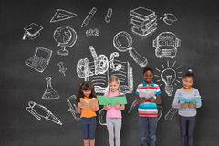 Composite image of elementary pupils reading Royalty Free Stock Images
