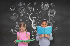 Composite image of elementary pupils reading Stock Photography