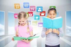 Composite image of elementary pupils reading Stock Photo