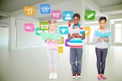 Composite image of elementary pupils reading Royalty Free Stock Photo