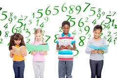 Composite image of elementary pupils reading Stock Image