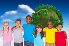 Composite image of elementary pupils smiling Royalty Free Stock Photos