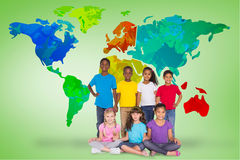 Composite image of elementary pupils smiling Royalty Free Stock Photo