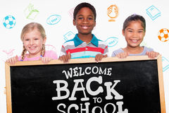 Composite image of elementary pupils smiling. Elementary pupils smiling against back to school royalty free stock photos