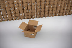 Composite image of empty cardboard box by stack of boxes royalty free illustration