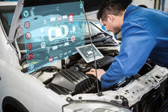 Composite image of engineering interface. Engineering interface against mechanic using tablet to fix car Stock Photo