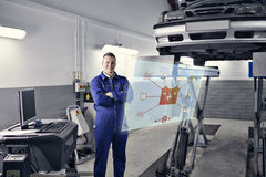 Composite image of engineering interface. Engineering interface against smiling mechanic standing next to a car Royalty Free Stock Images