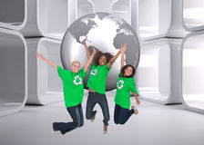 Composite image of enviromental activists jumping and smiling Stock Images