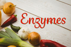 Composite image of enzymes. Enzymes against various vegetables on wooden table Royalty Free Stock Photos