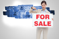 Composite image of estate agent holding and pointing to for sale sign Royalty Free Stock Images