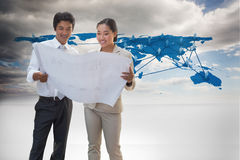 Composite image of estate agent looking at blueprint with potential buyer Royalty Free Stock Photography