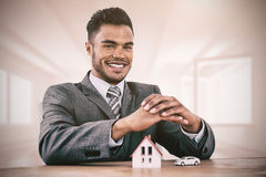 Composite image of estate agent smiling stock photos