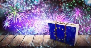 Composite image of eu flag suitcase. EU flag suitcase against fireworks exploding over football stadium Stock Photography