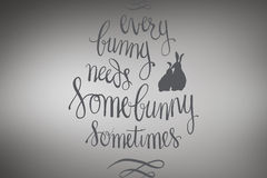 Composite image of every bunny needs some bunny sometimes. Every bunny needs some bunny sometimes against grey vignette Stock Photography