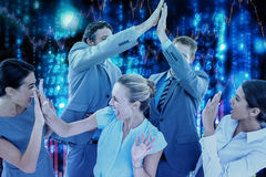 Composite image of excited business team cheering Stock Image