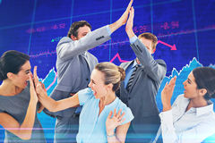 Composite image of excited business team cheering Royalty Free Stock Image