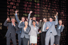 Composite image of excited business team cheering at camera Royalty Free Stock Photography