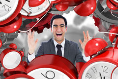 Composite image of excited businessman with arms raised Royalty Free Stock Photos