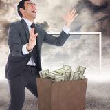Composite image of excited businessman catching Royalty Free Stock Image