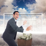 Composite image of excited businessman catching Royalty Free Stock Photography