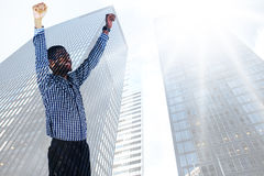 Composite image of excited businessman cheering Royalty Free Stock Photography