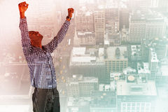 Composite image of excited businessman cheering Stock Photos
