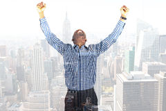Composite image of excited businessman cheering Royalty Free Stock Photo