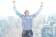 Composite image of excited businessman cheering Royalty Free Stock Images