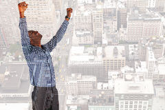 Composite image of excited businessman cheering Stock Photo