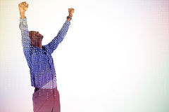 Composite image of excited businessman cheering Royalty Free Stock Photos