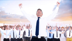 Composite image of excited businessman with glasses cheering Royalty Free Stock Photo