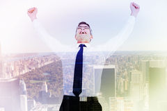 Composite image of excited businessman with glasses cheering Stock Photos