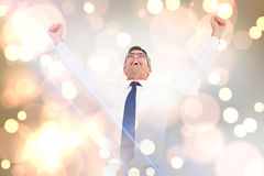 Composite image of excited businessman with glasses cheering Royalty Free Stock Image