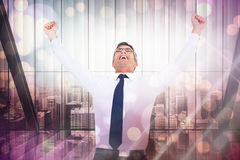 Composite image of excited businessman with glasses cheering Royalty Free Stock Photos