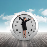 Composite image of excited businesswoman cheering Royalty Free Stock Image