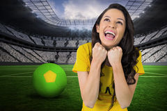 Composite image of excited football fan in brasil tshirt Royalty Free Stock Photography
