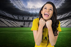 Composite image of excited football fan in brasil tshirt Royalty Free Stock Photo
