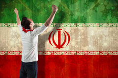 Composite image of excited football fan cheering. Excited football fan cheering against iran flag in grunge effect Stock Images