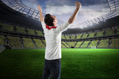 Composite image of excited football fan cheering Royalty Free Stock Image